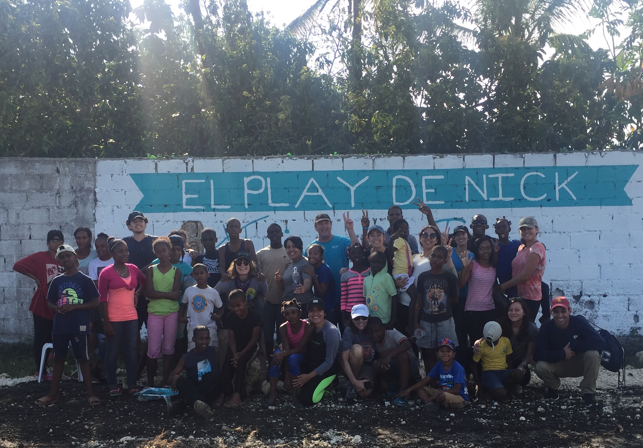 Children of the remar orphanage with mary & Jay fagnano are joined by Josue Najera (NDHS '12) and students from the USC caruso catholic center who traveled to the dominican republic in march 2017. this picture was taken at the dedication of the baseball field that was completed thanks to the generosity of thrive in joy nick fagnano foundation donors.