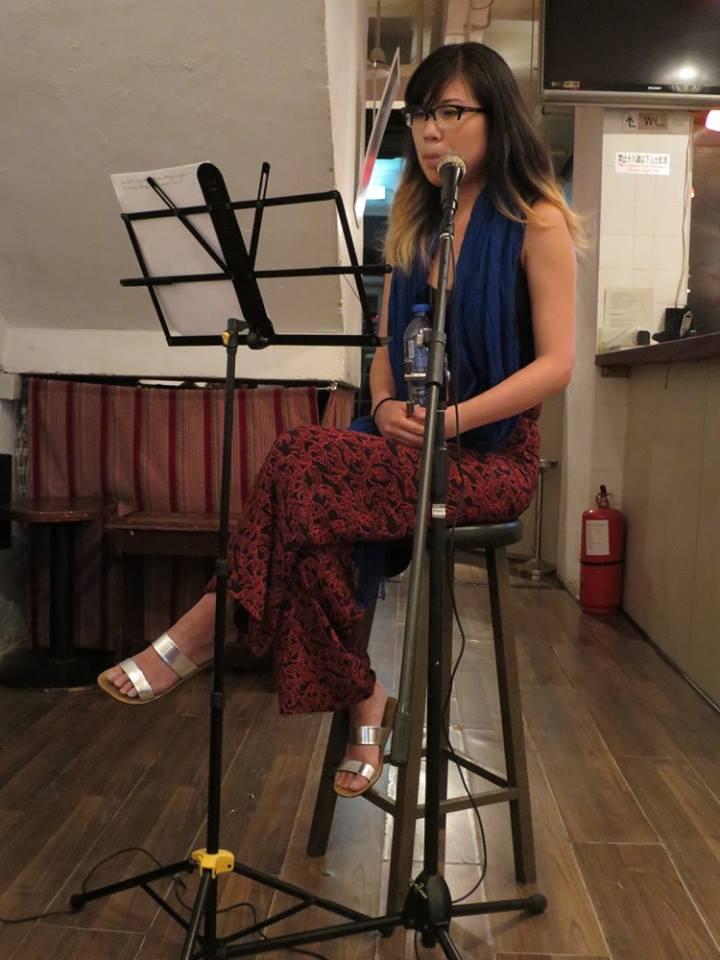 Reading a short story at a literary salon in Hong Kong