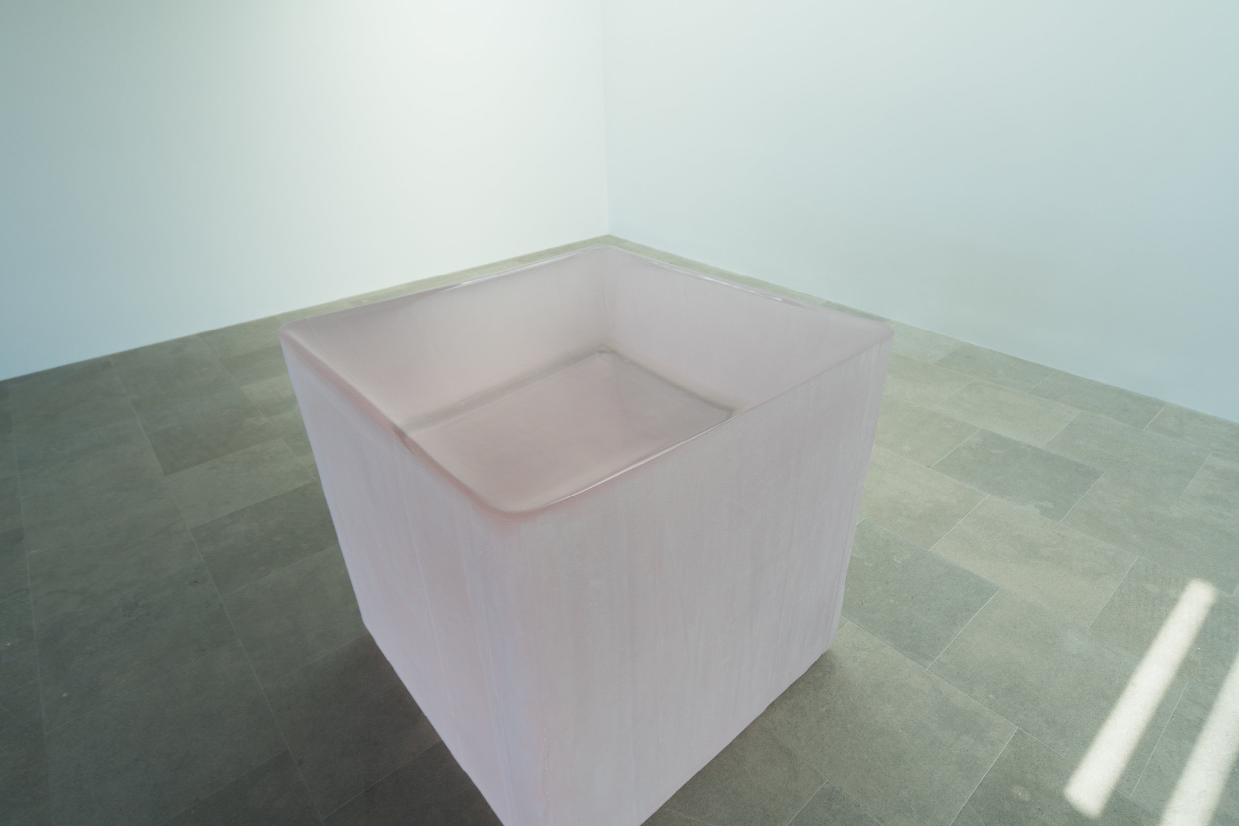 Pink Tons , 2008-2011, solid glass with as-cast surfaces, 48 x 48 x 48 inches.