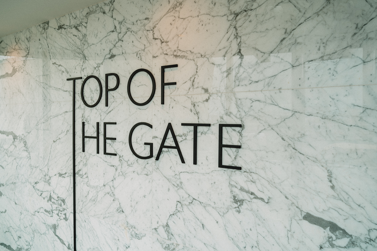 Clever signage at the entrance to the rooftop bar, Top of the Gate, at the Watergate Hotel.