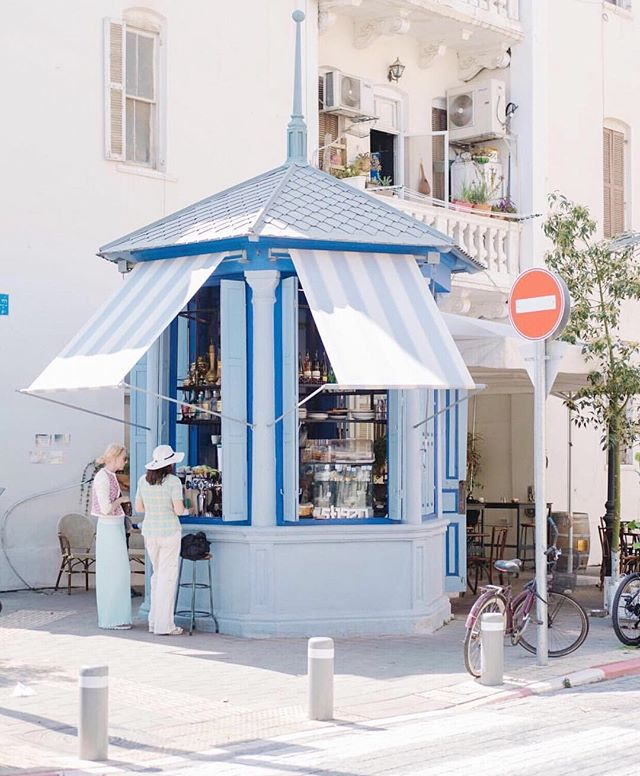 picture perfect #rothschild boulevard. take a lazy afternoon stroll down the boulevard and stop by one of the many cute kiosks for a coffee and snack.  photo by @viatolila