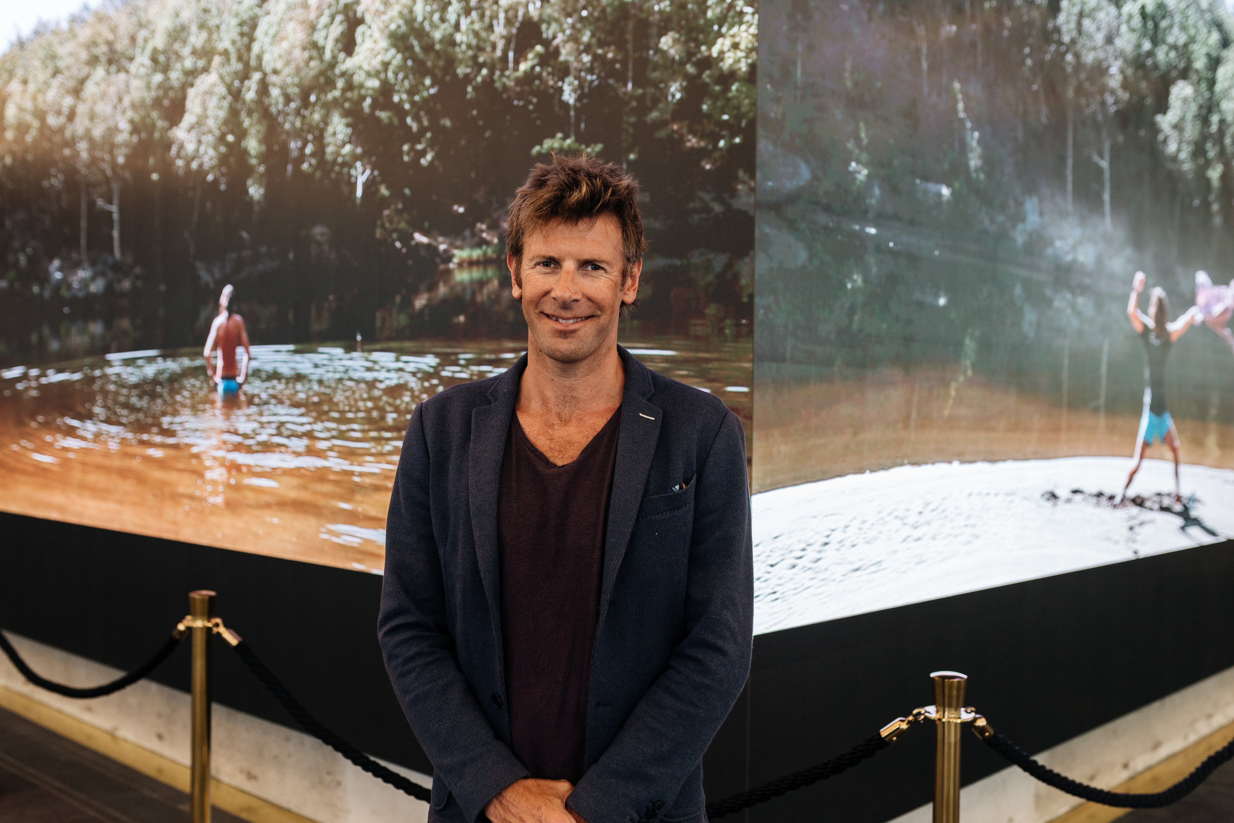 Chris Bennie in front of his video installation for 100 Creek Street.