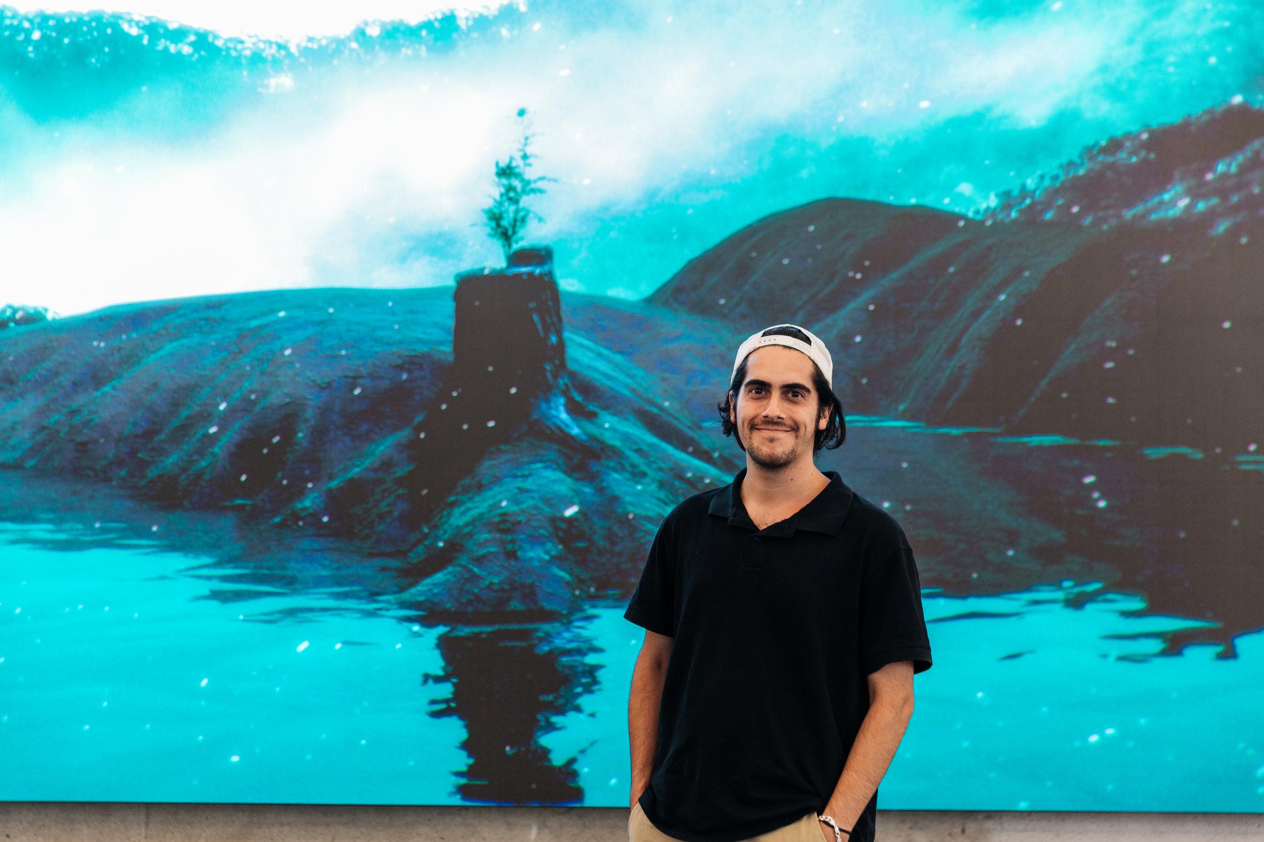 Artist Matt Schembri in front of his digital artwork at 100 Creek Street, Brisbane. Credit: Art Pharmacy Consulting/Savannah van der Niet