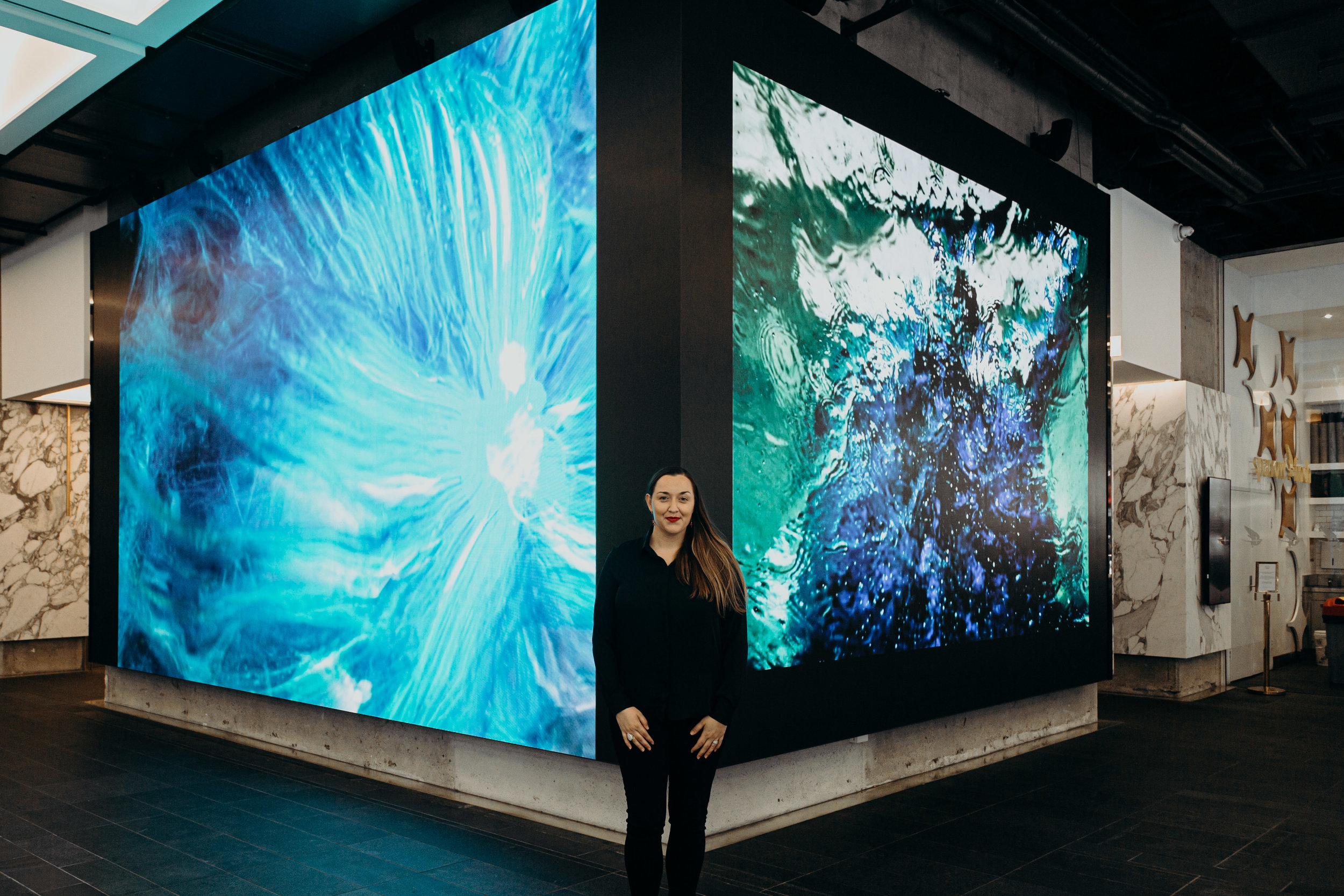 Stefania Shevchenko with her digital artwork, Space - Ocean Continuum. Image credit: Art Pharmacy Consulting / Anwyn Howarth.