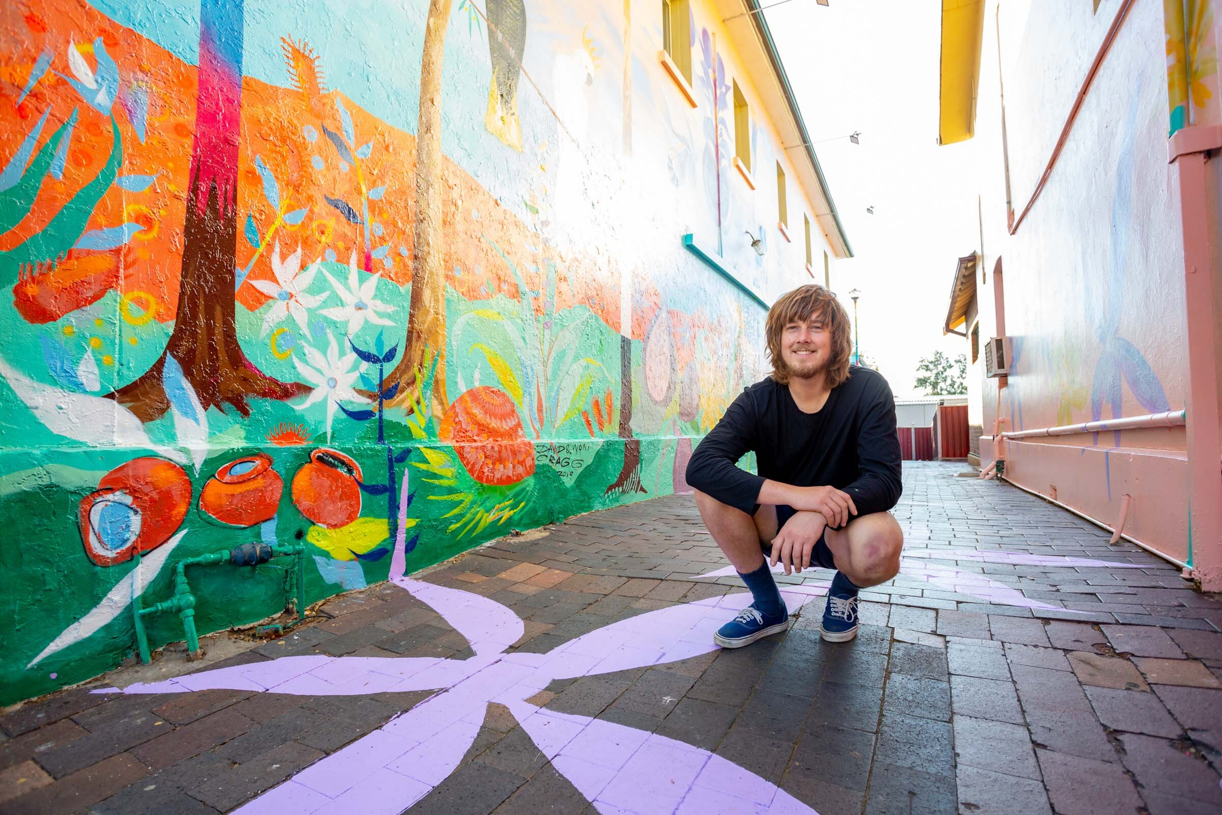 David Cragg in front of his mural in Windsor. Image credit: Art Pharmacy Consulting / Jodie Barker