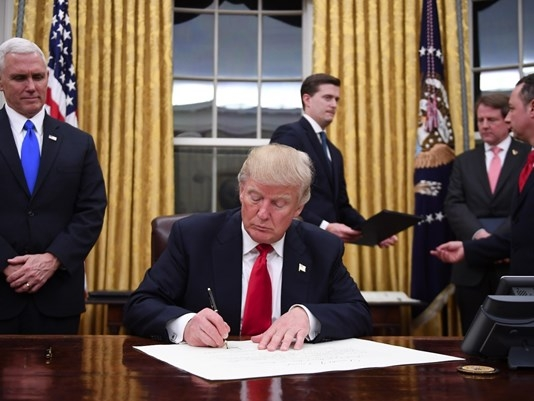 Just minutes after taking the Oath of Office, President Trump took action to begin work repealing Obamacare. Vice President looks on as the Executive Orders are being signed.