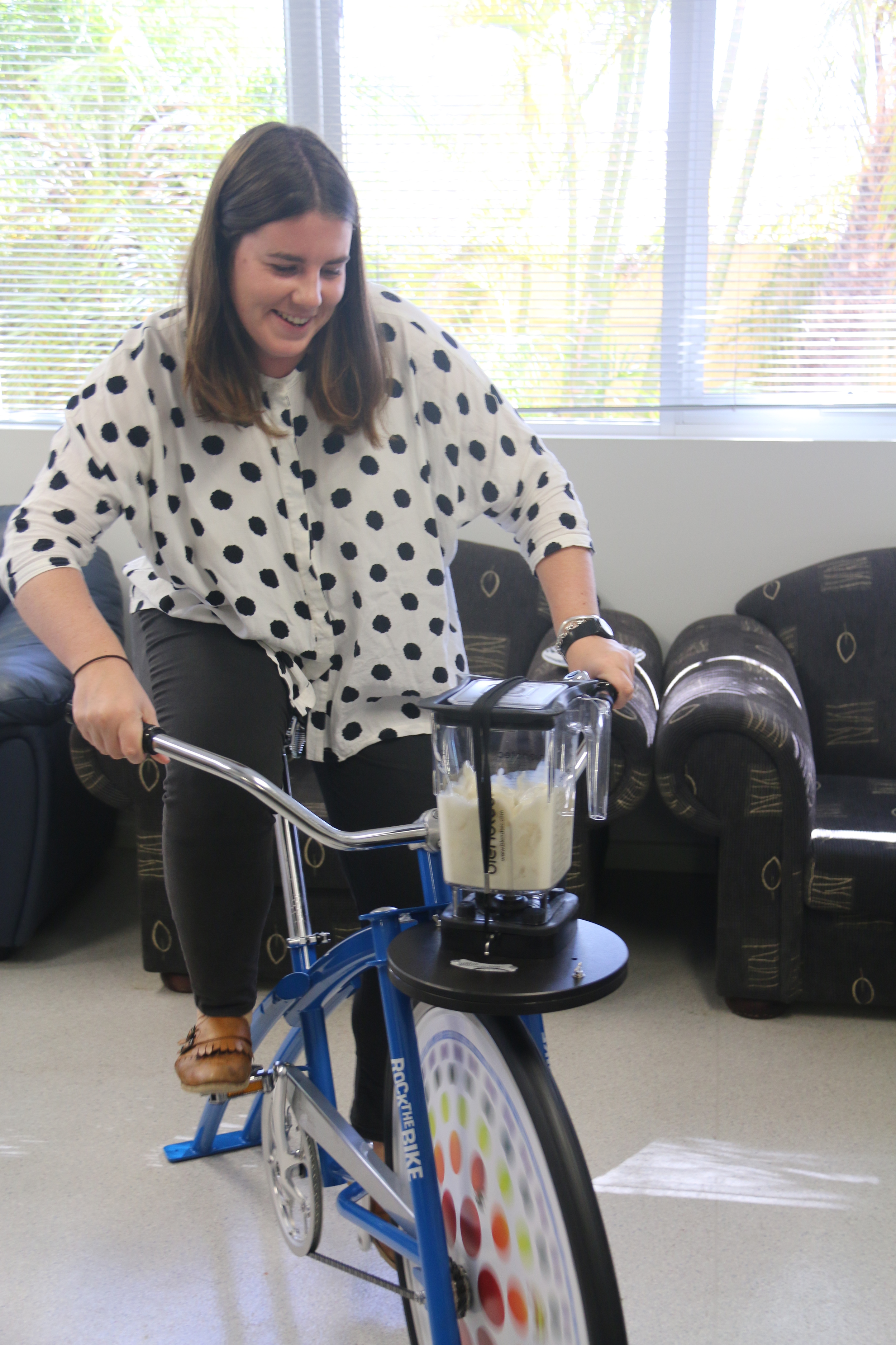 WACRH Research Assistant Fiona Lucy demonstrating how to make a smoothie on the Fender Blender Bike.