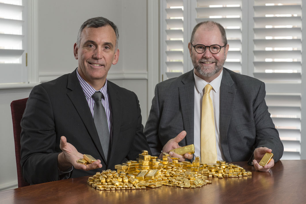 John Welborn, Managing Director & CEO Resolute Mining Limited, with Richard Hayes, Perth Mint Chief Executive Officer, and part of the Resolute dividend payment in gold bullion.