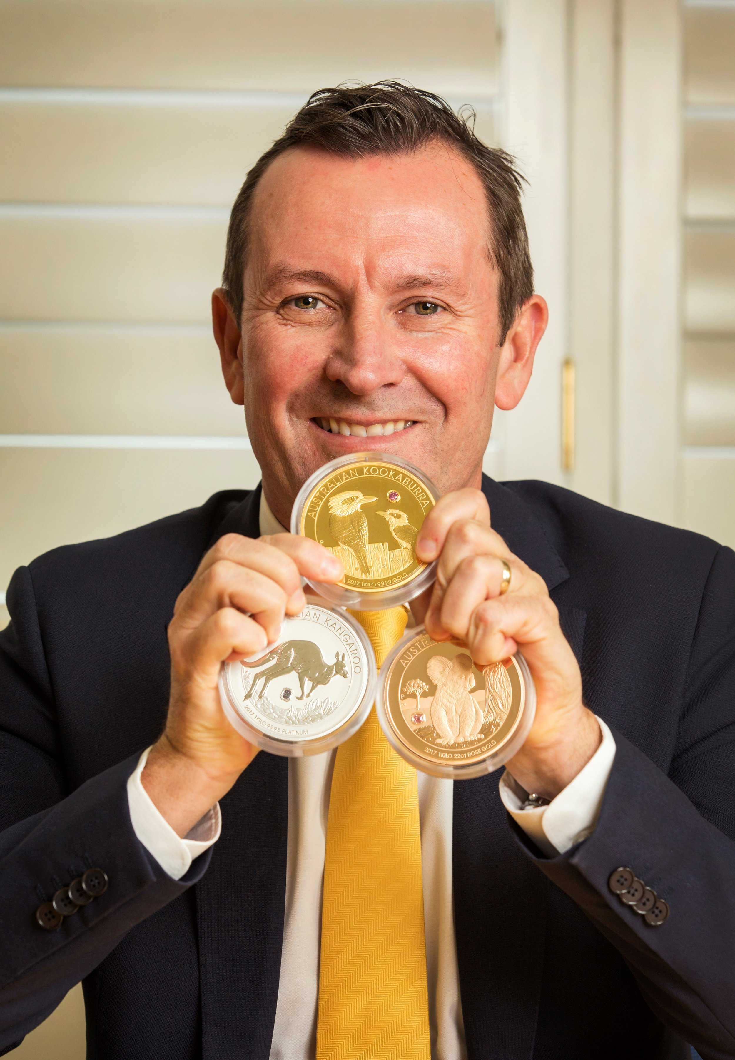 Honourable Mark McGowan MLA holding The Australian Trilogy