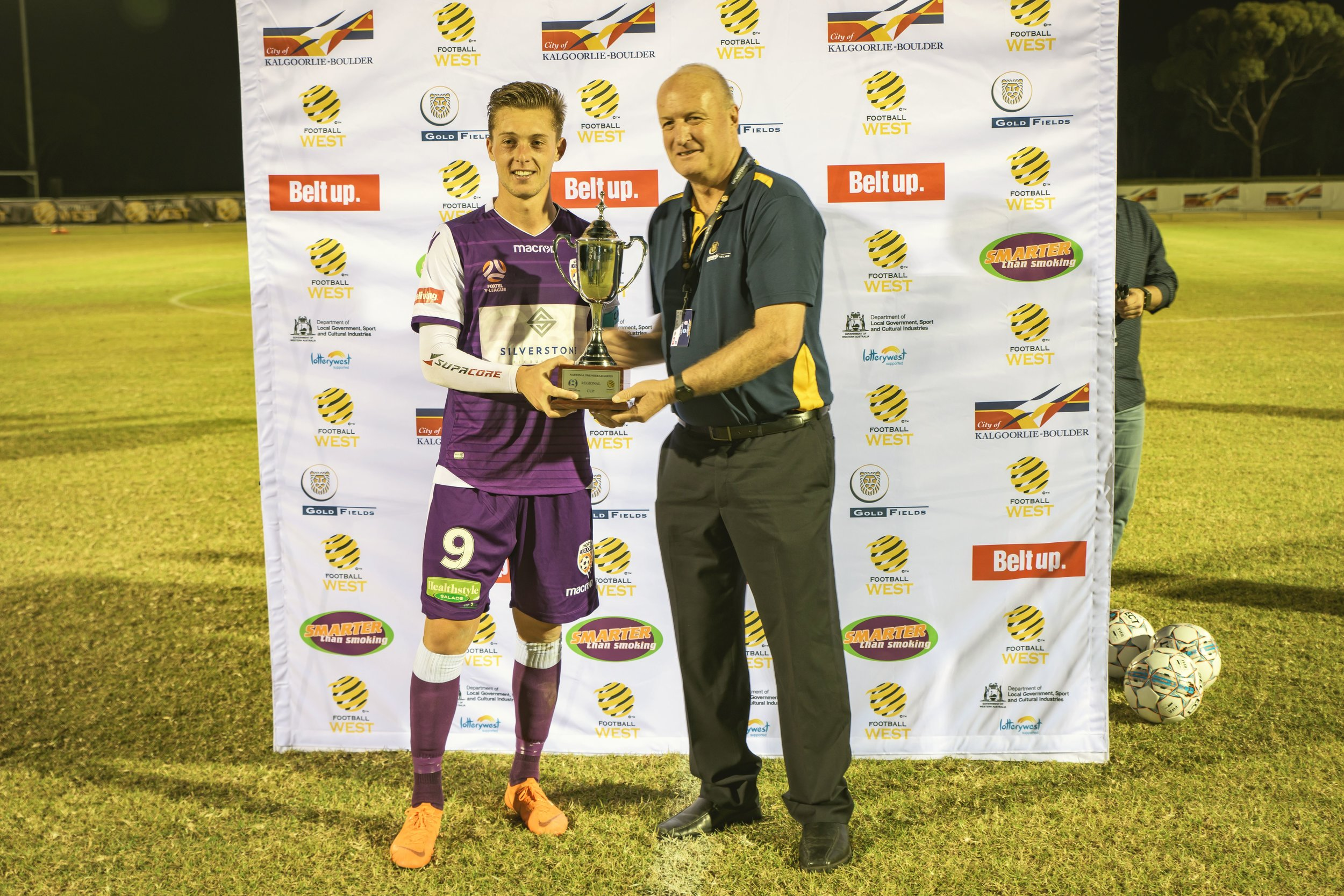 Gold Fields Executive Vice President (Australasia) Stuart Mathews presents the trophy to Perth Glory Youth's captain. Source: Football West