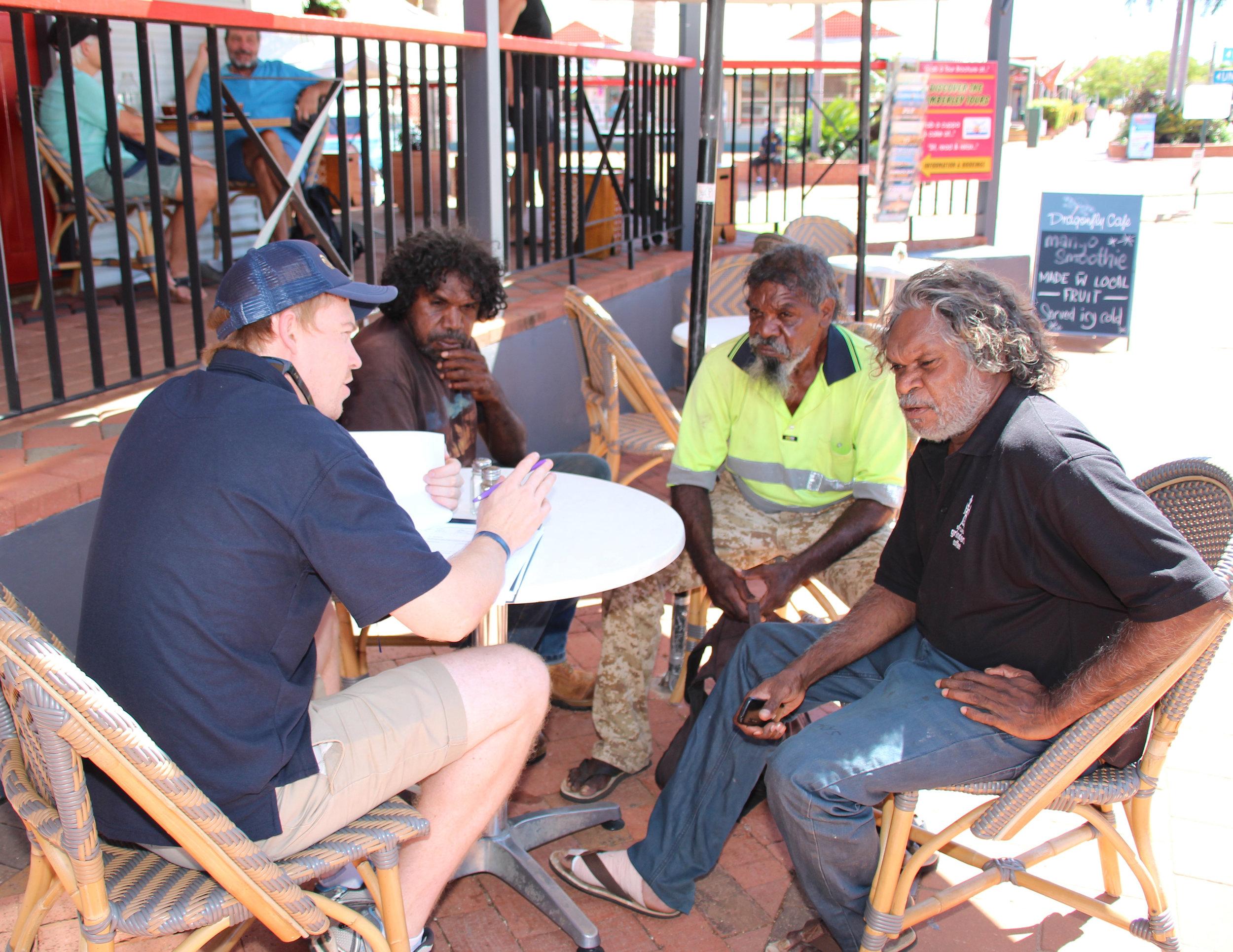 Newcrest Community Relations Advisor, Daniel Tincknell (left), speaks with community members in Broome.