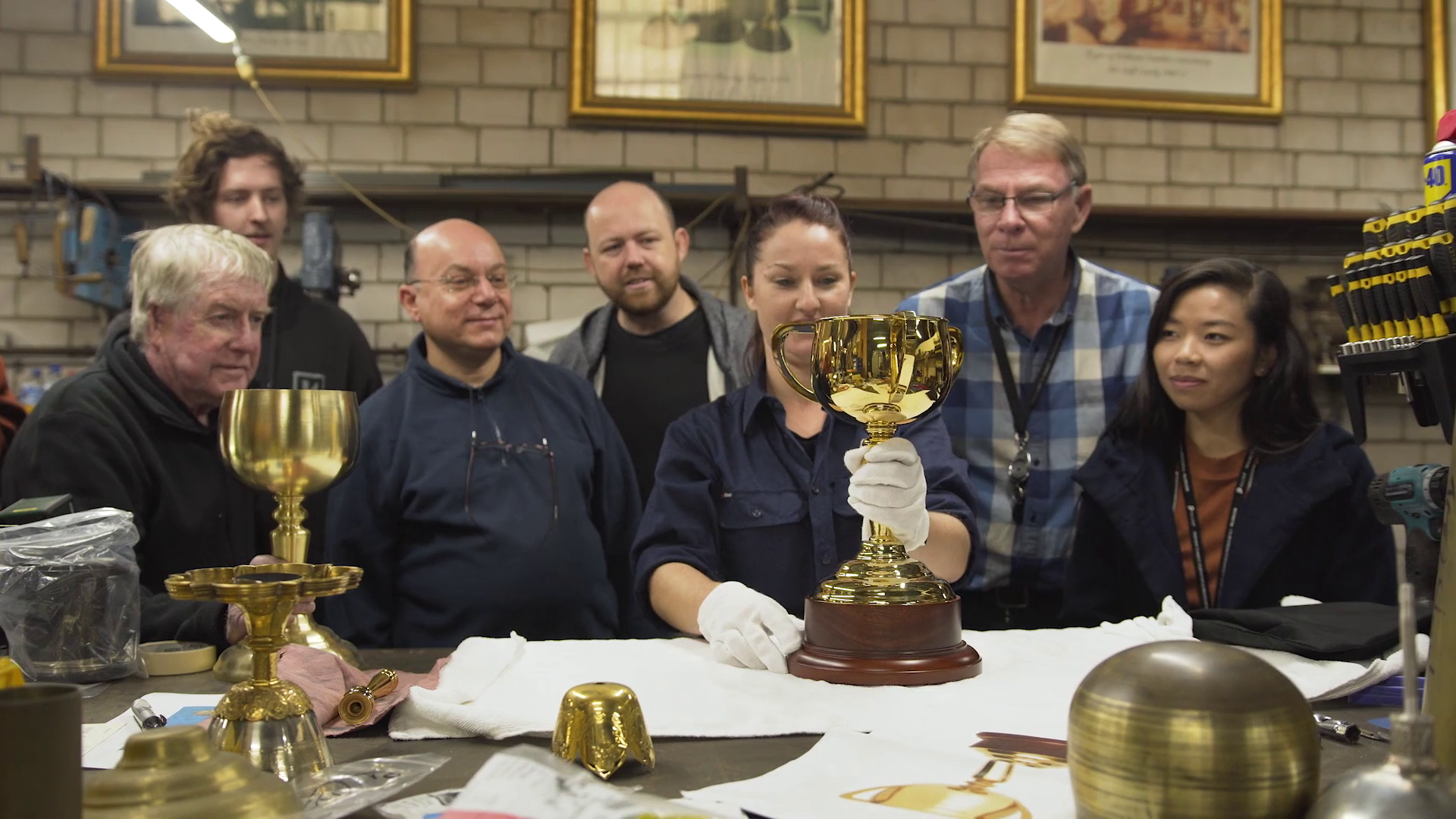 The ABC Refinery team carefully piecing the 2018 Lexus Melbourne Cup together.