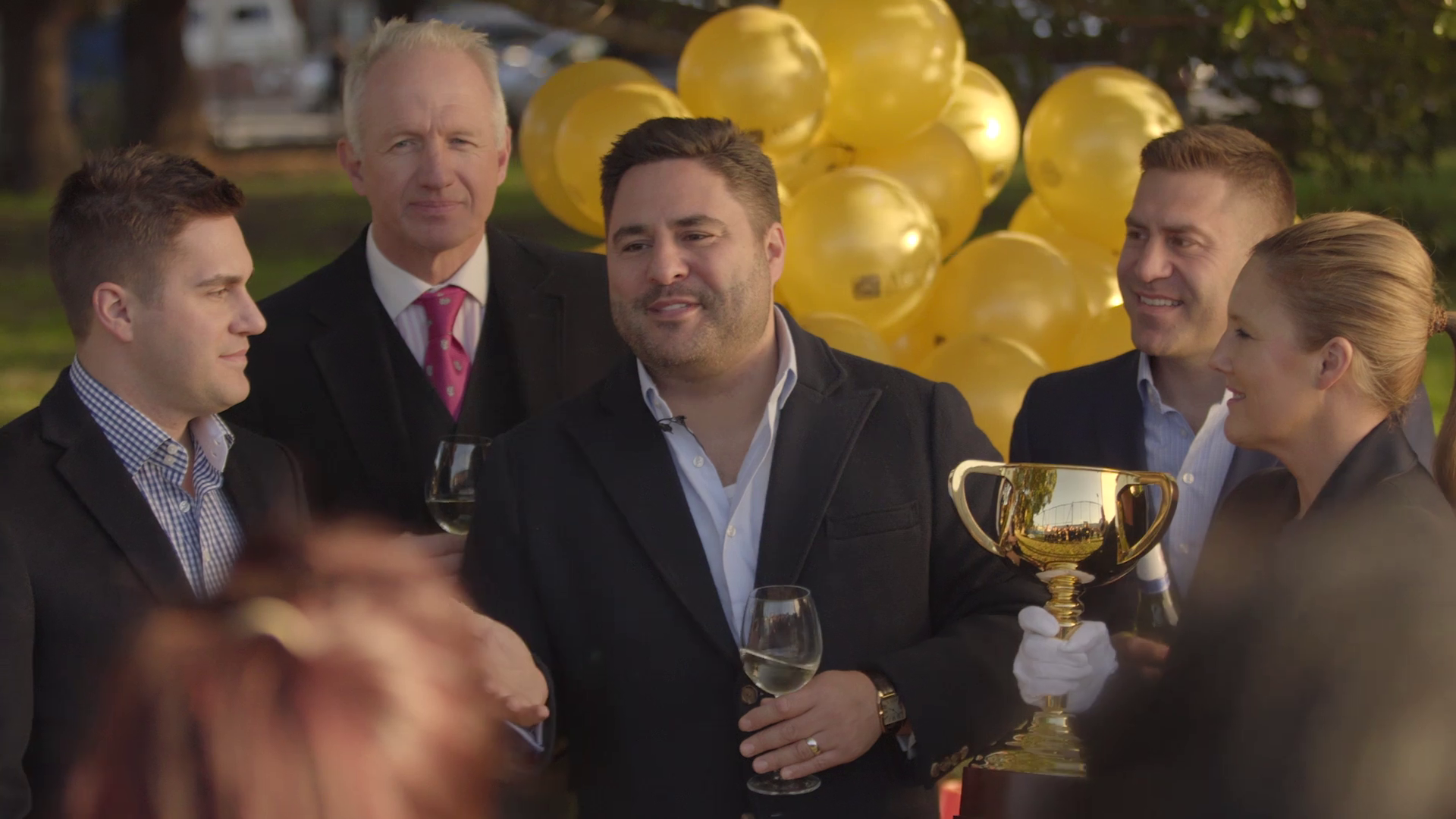 ABC Refinery's Paul and Phillip Cochineas, with Victorian Racing Club's Racing Engagements and Cup Tour Manager Joe McGrath, celebrating the making of the 2018 Lexus Melbourne Cup.