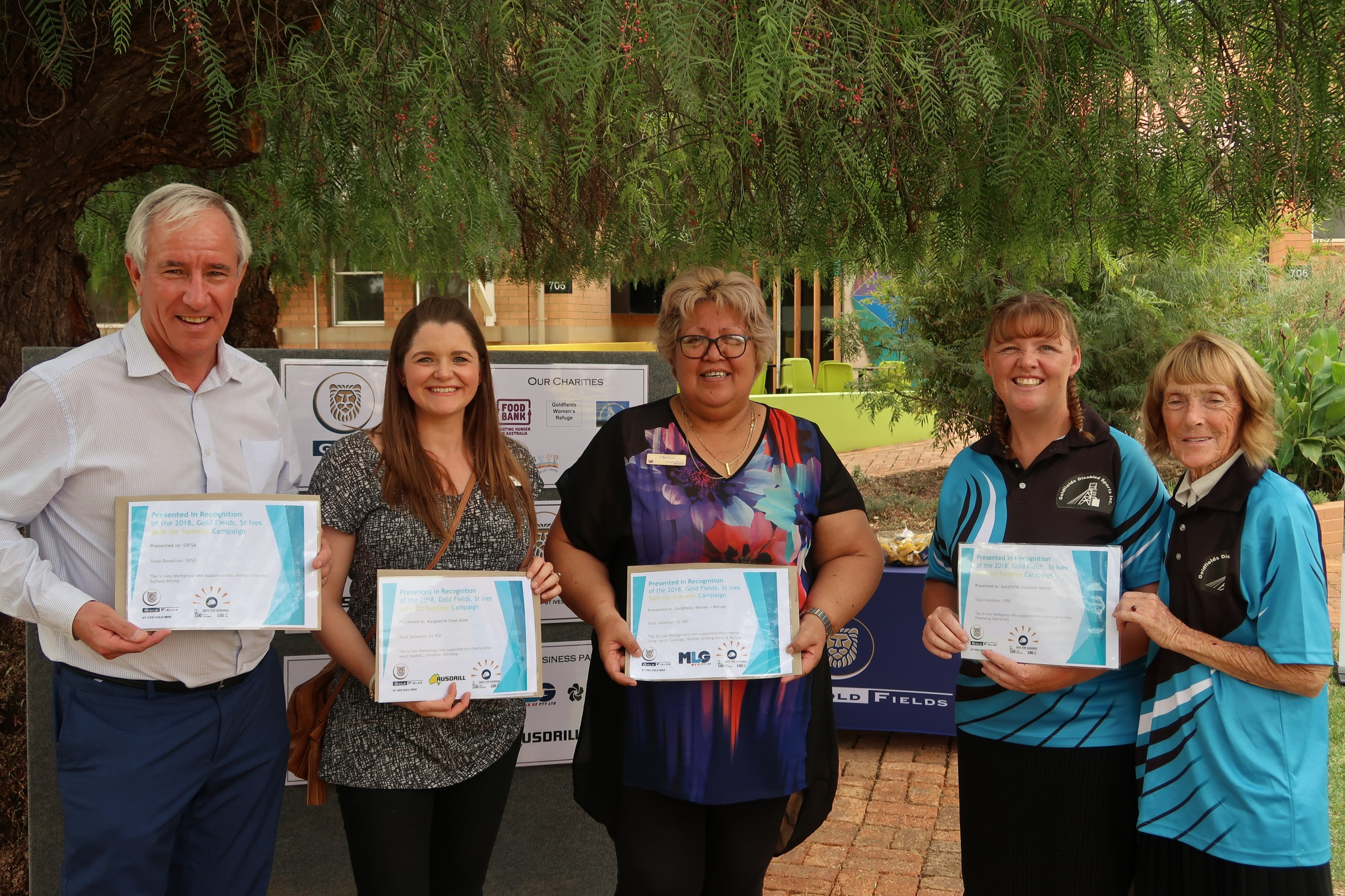 (L-R) Charity recipients: Robert from GIFSA, Debora from Kalgoorlie Food Bank, Jacqui from Goldfields Women's Refuge and Erin and Pat from the Goldfields Disability Sports Association.