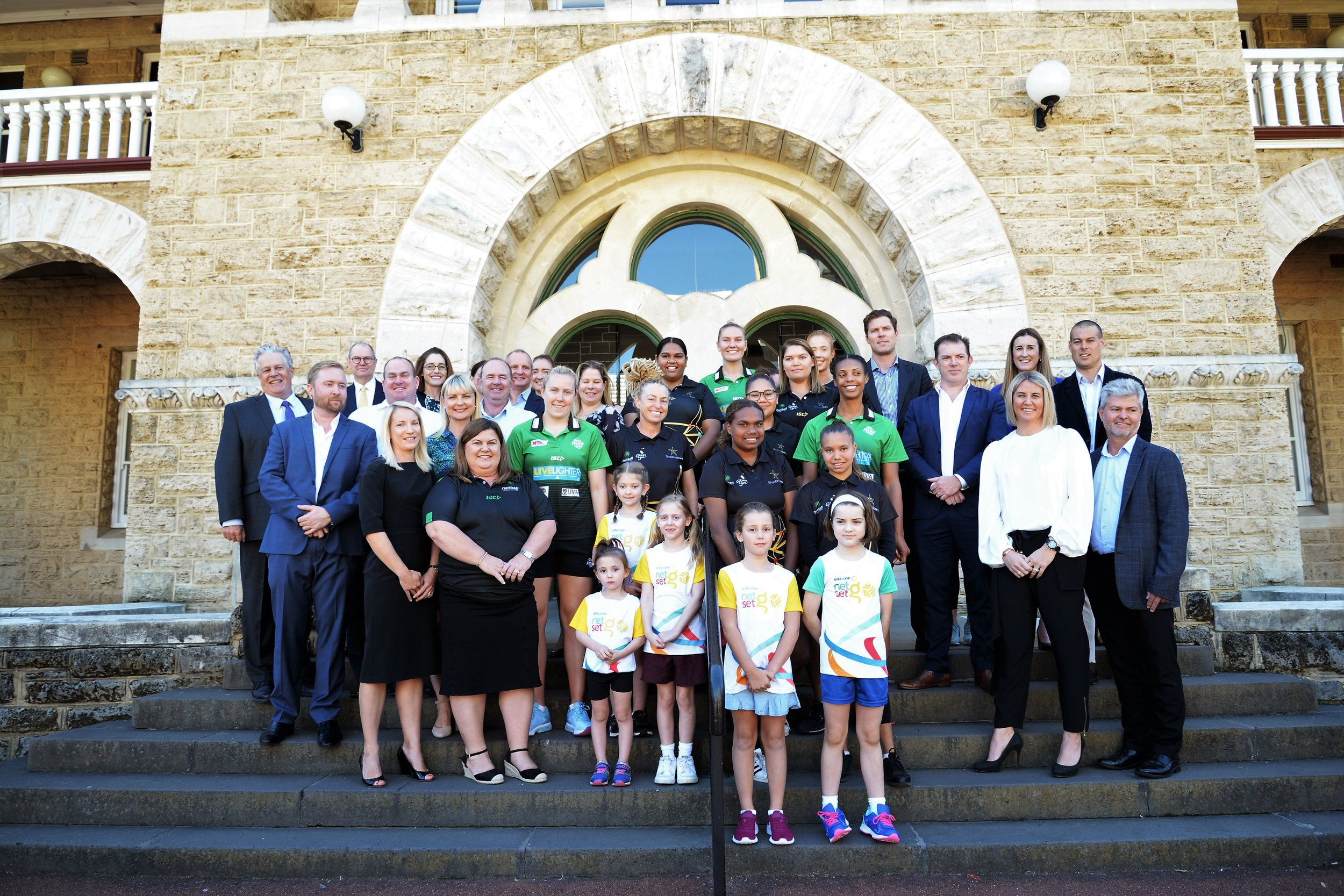 The Gold Industry Group, members, Netball WA, West Coast Fever and Shooting Stars representatives pose for a photo at today's landmark partnership announcement.
