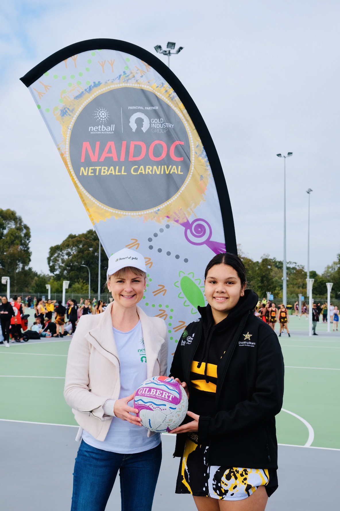 GIG Executive Officer Rebecca Johnston with Aboriginal artist and NAIDOC Netball Carnival designer Shontae Jetta.