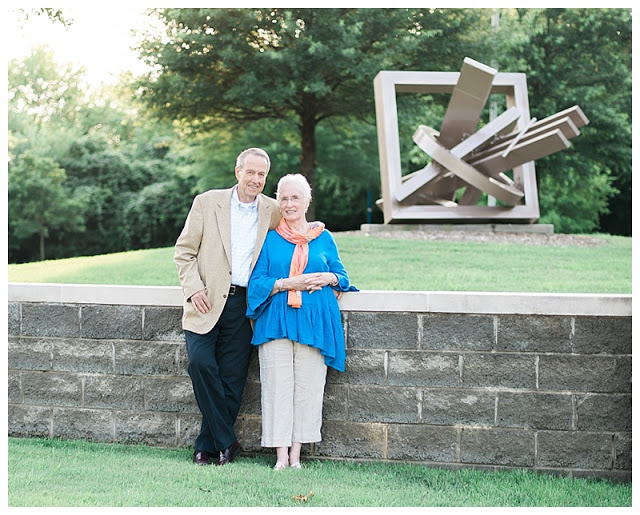 In front of a sculpture along the Chattanooga Riverwalk