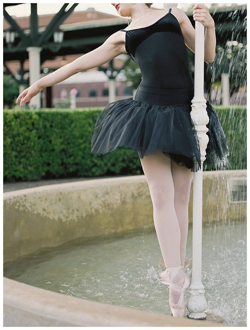 Ballerina on pointe in fountain
