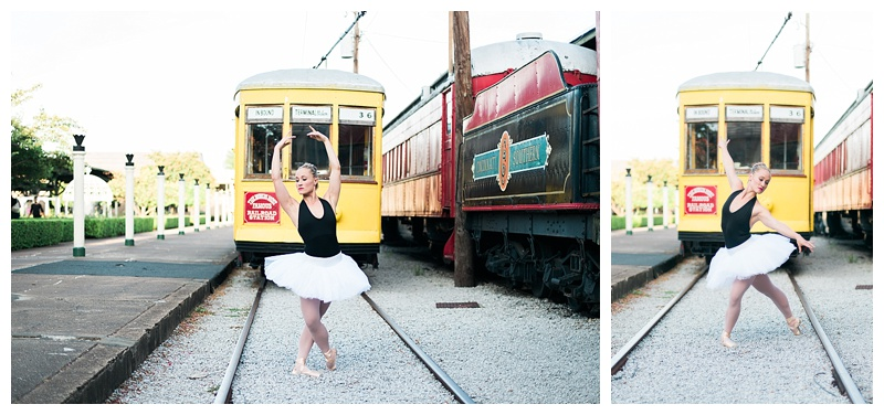 Professional ballerina on tracks by vintage trains at the Chattanooga Choo Choo Hotel
