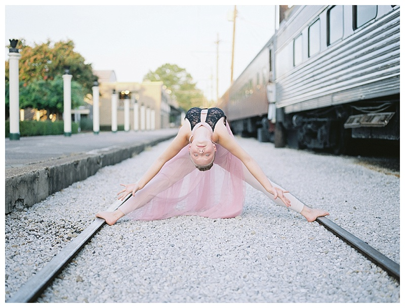 Ballerina on train tracks