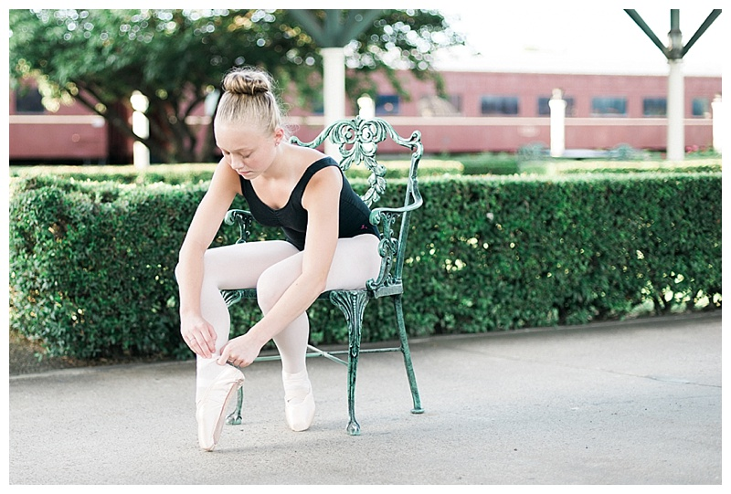 Ballerina tying shoes