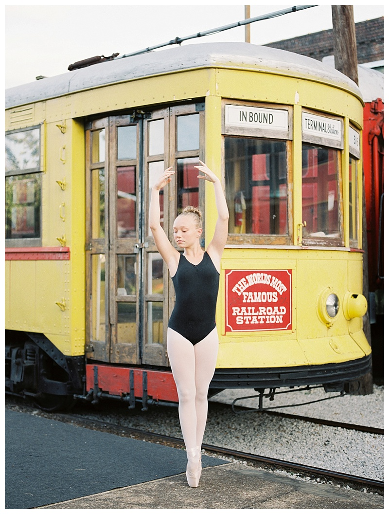 Ballerina on pointe by vintage trolley