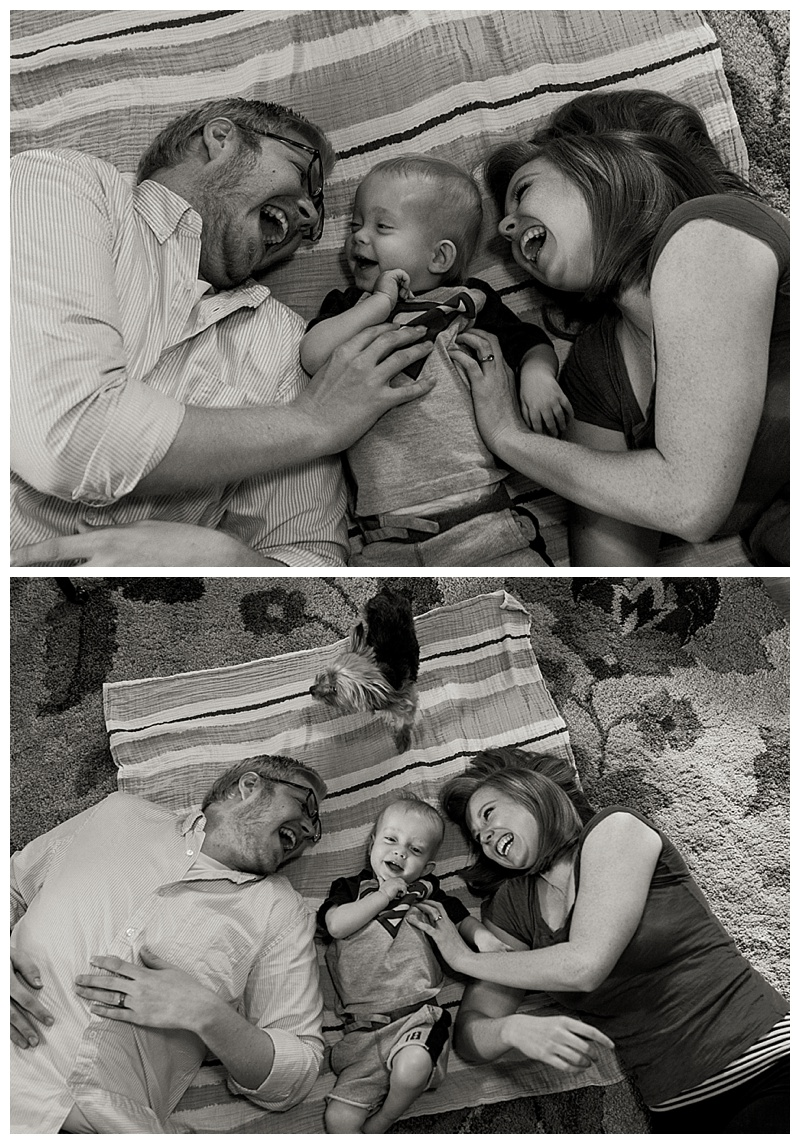 Family giggling together on the floor