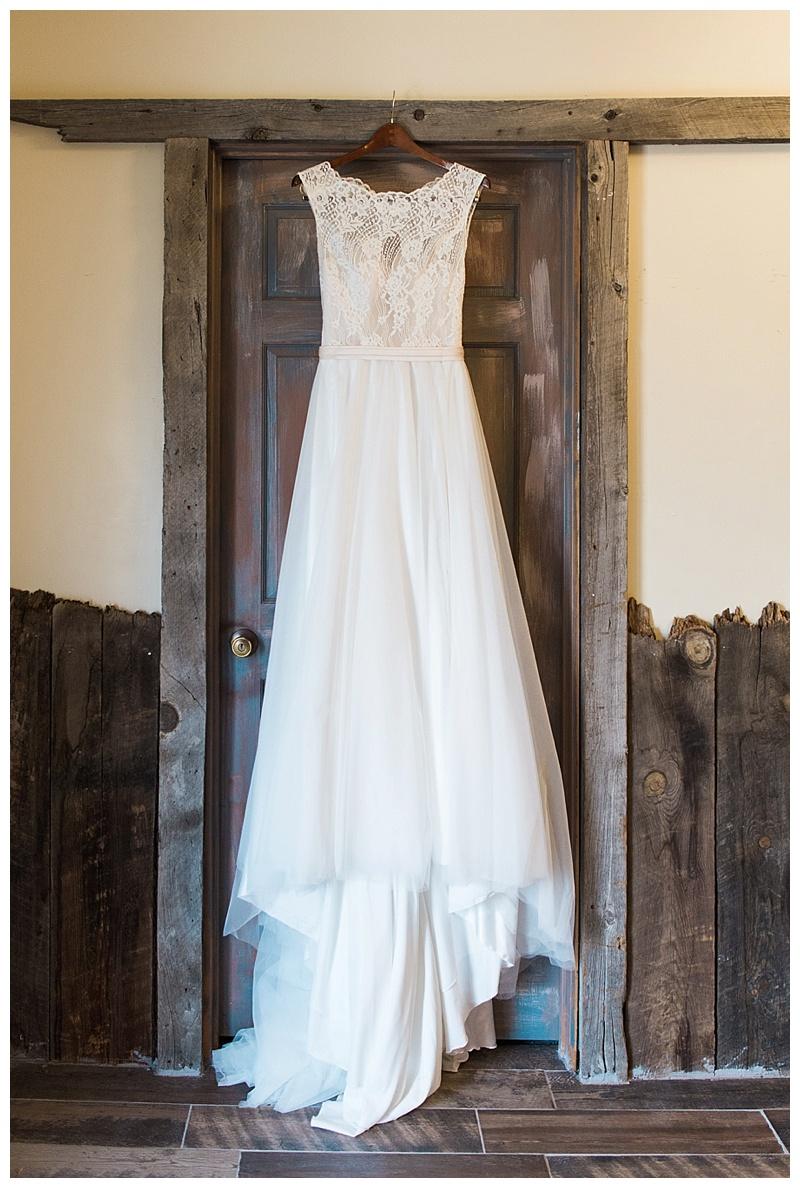 Wedding Dress on Rustic Wooden Door