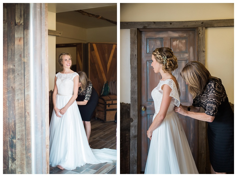Mother of the bride buttoning the dress
