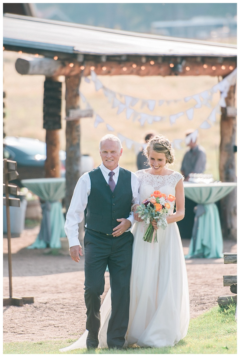 Father of the bride walking bride to wedding at the Barn at Memorial Park in Evergreen CO