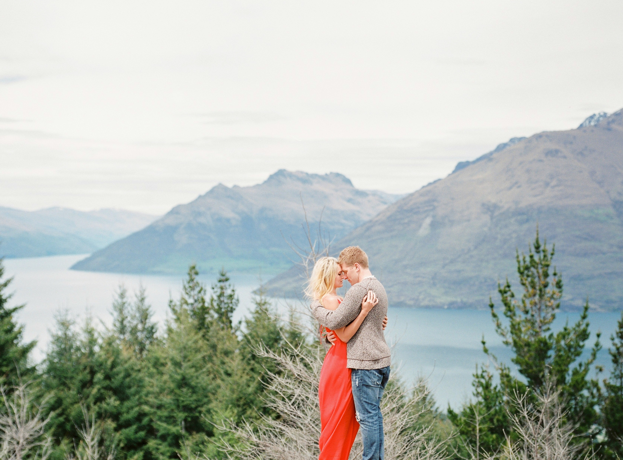 Red dress engagement session in Queenstown top of the hill