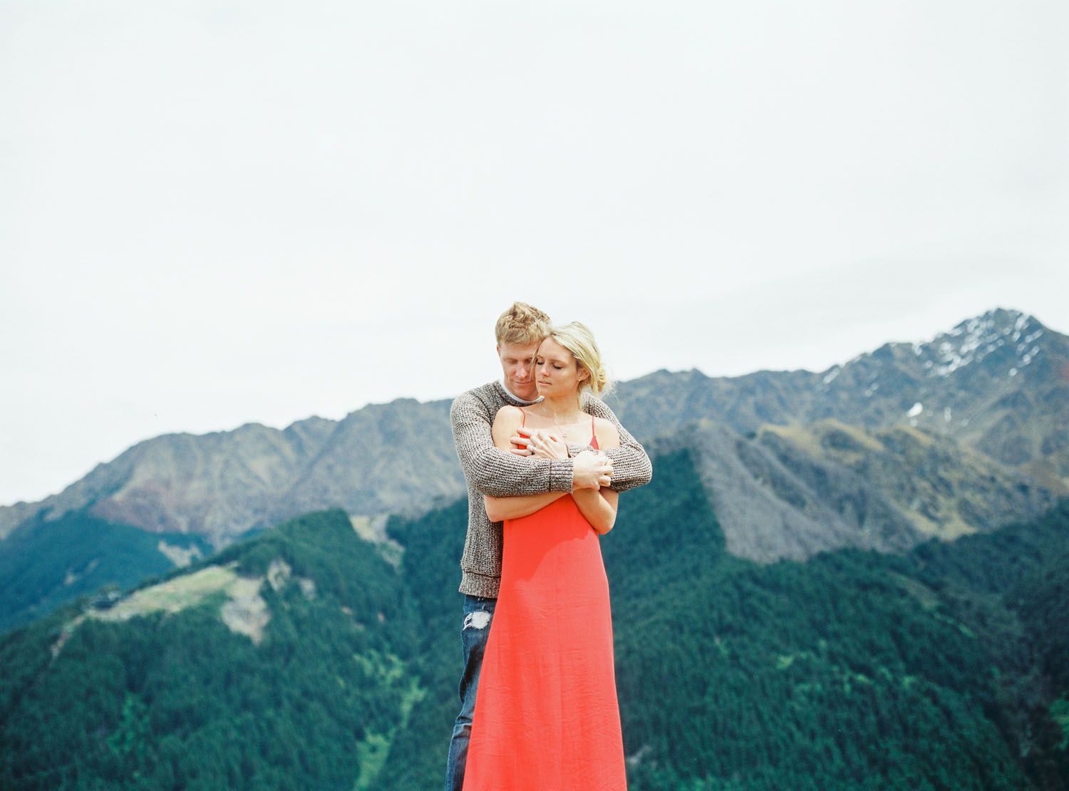 Red dress girl for engagement session in New Zealand