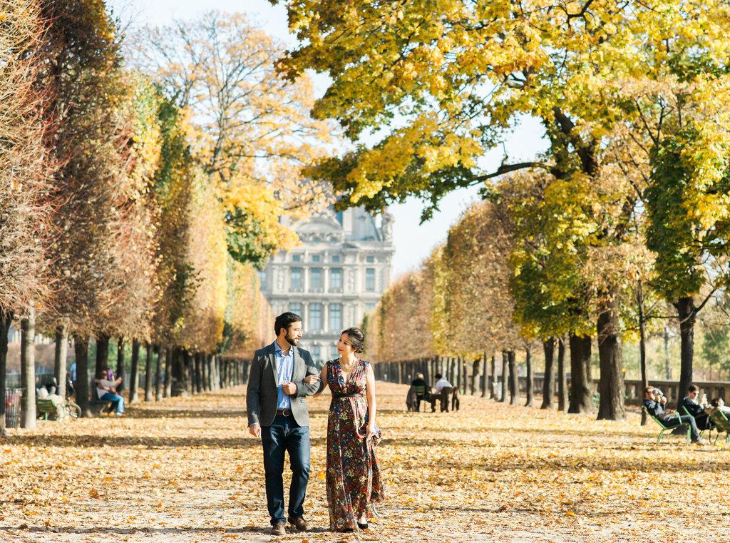 Couple walking in theParisian Autumn Tuileries Garden