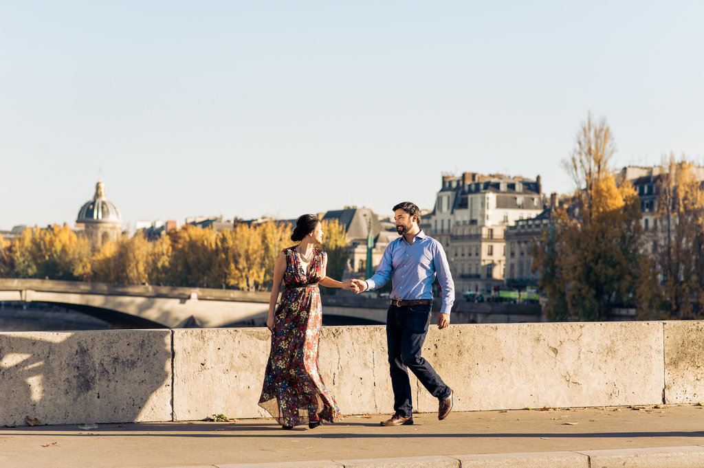 Walking along river Seine in Paris hand in hand anniversary session