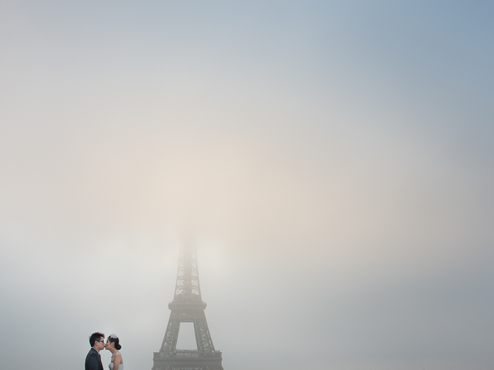 Whimsical image of a wedding couple in front of the Eiffel Tower