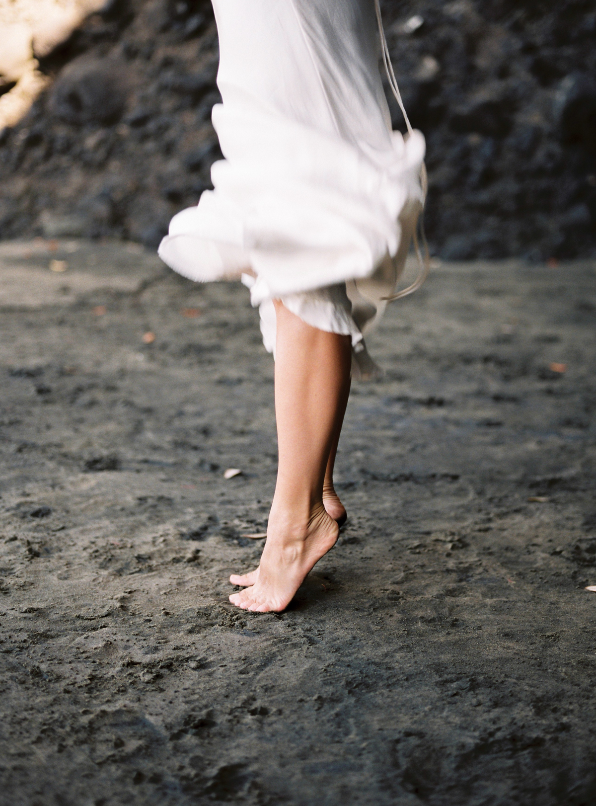 Barefoot bride on the beach dress movement