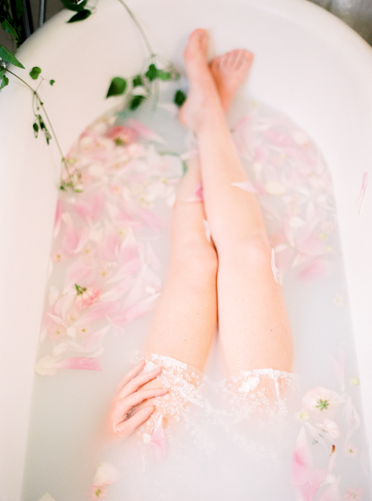 Ethereal boudoir session in a milk bath