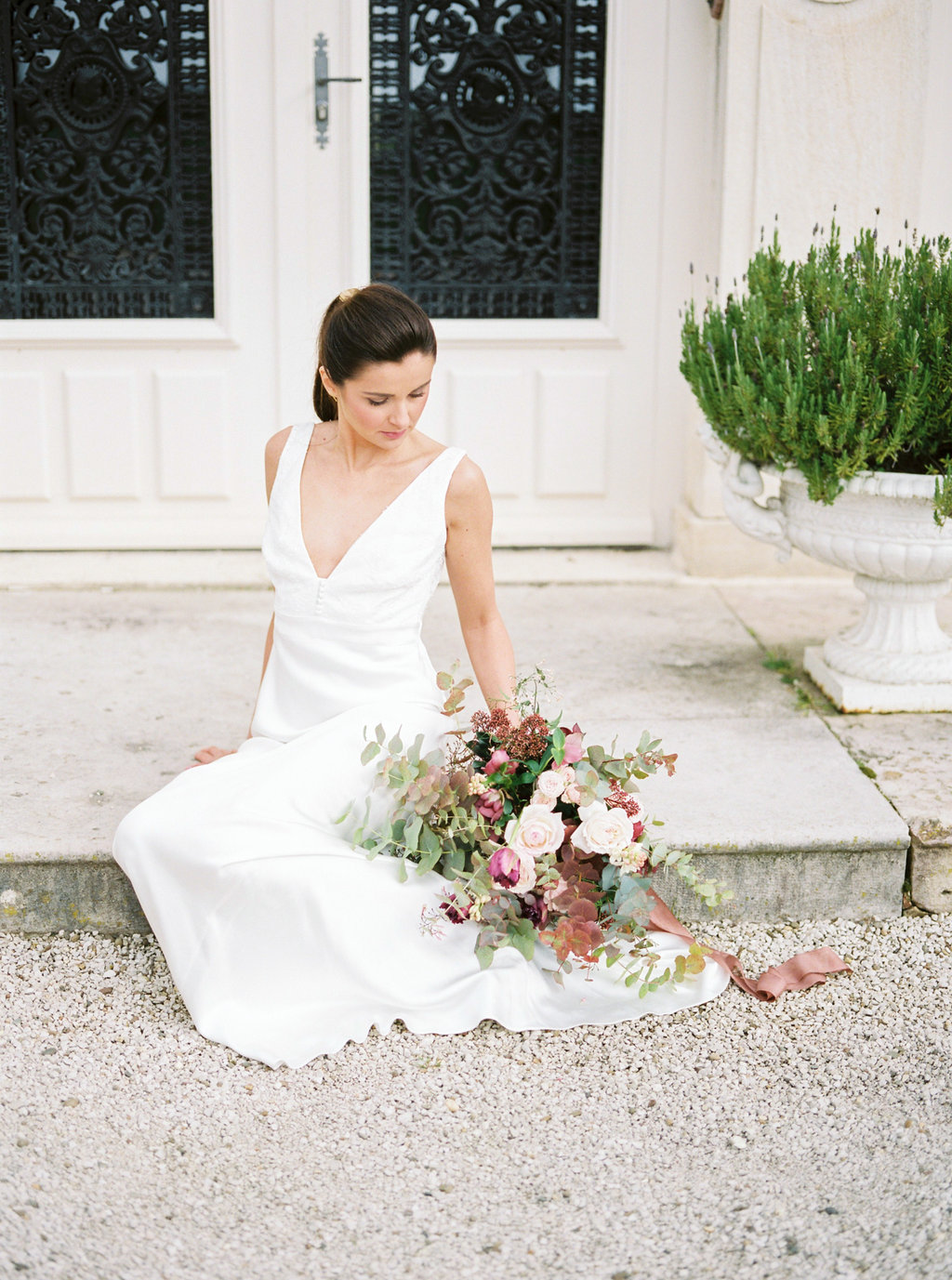 Bride with wedding bouquet wearing Charlie Brear dress