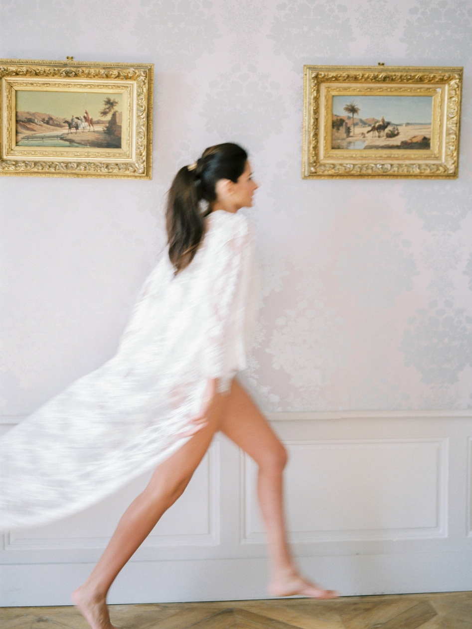 Elegant bride in French lace robe