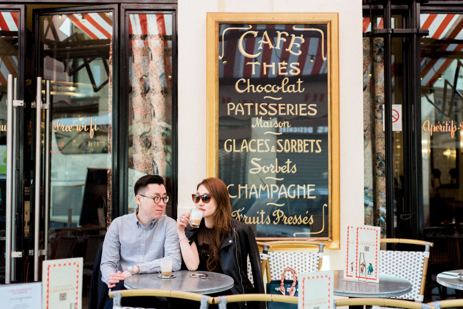 Cute café in Paris engagement photo