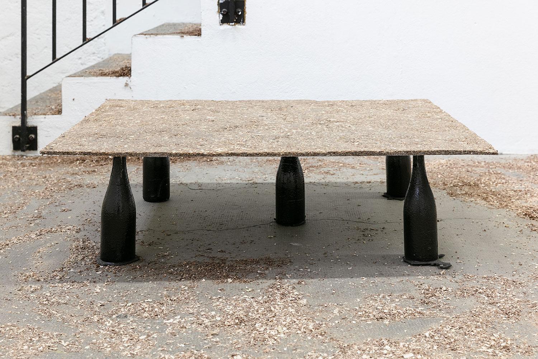 OLU OGUNNAIKE  LOST ENDS, 2018 Wood dust, resin, charcoal, bottles, dimensions variable Courtesy the artist,  Photo: Paul Nicoué
