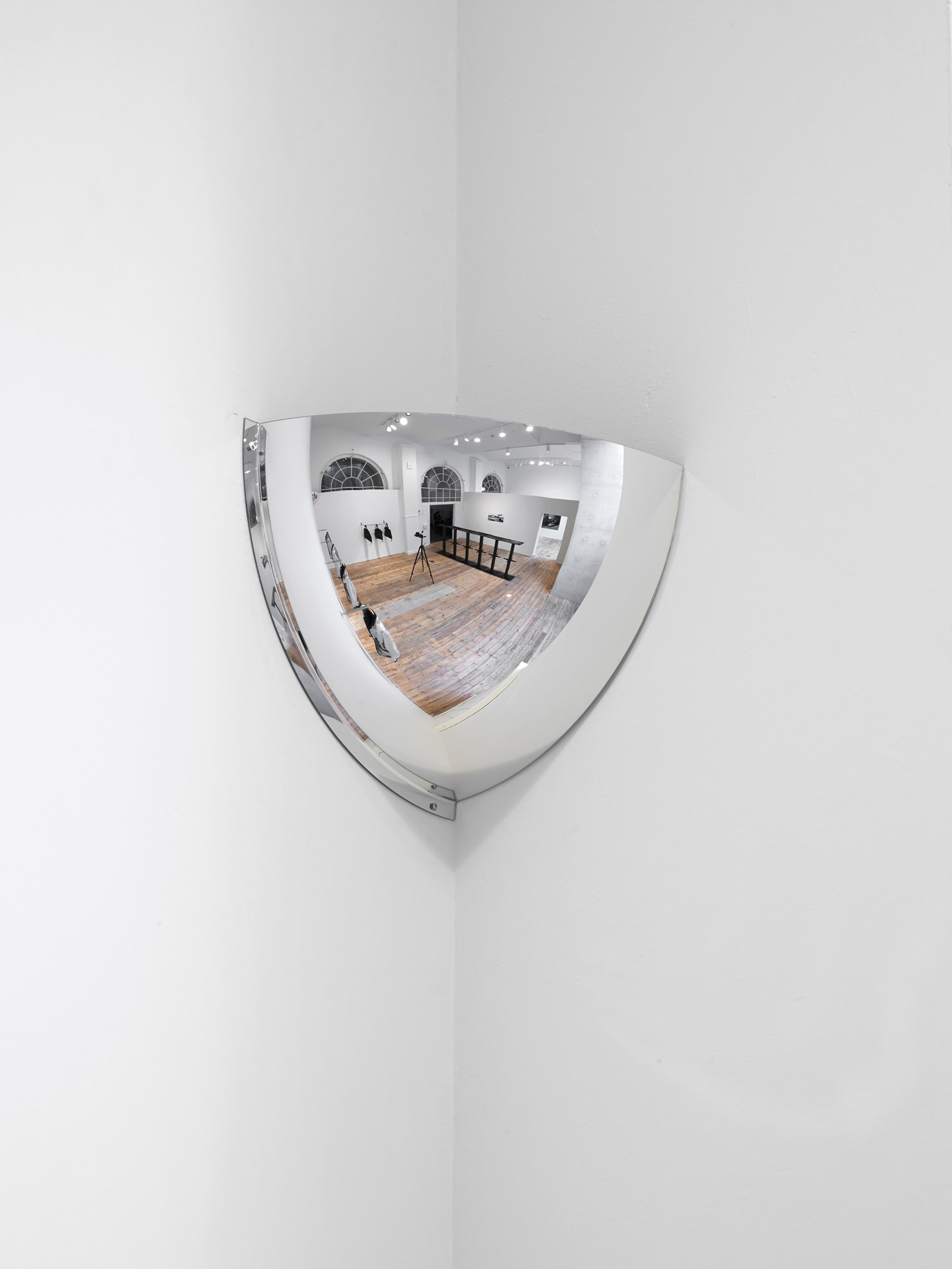 Guarded View 2019  Débora Delmar  Wide-angle wall 1/4 dome mirror 42 cm-Panoramic 90  (toughened acrylic), 42 x 42 cm