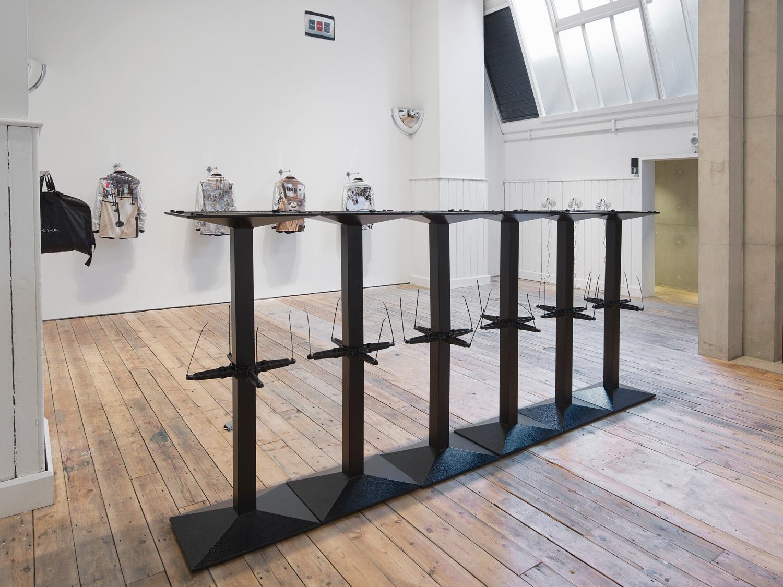 Barrier 2019 Débora Delmar  Twelve Bolero cast-iron rectangular table bases, cable ties,  145.8 x 3300 x 40 cm (each base 72.9 x 55 x 40 cm)