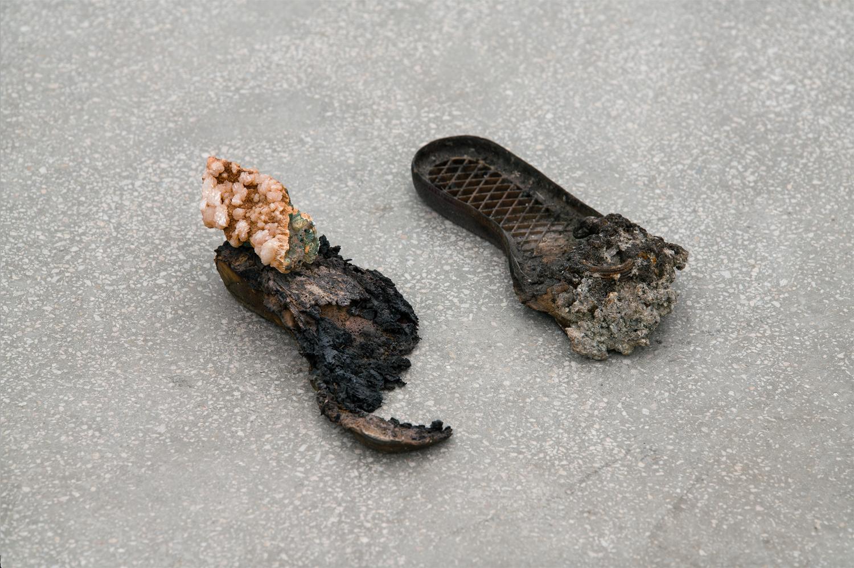 Footprints 2018 Nicolas Lamas  Burned rubber, melted metal, mineral Variable dimensions