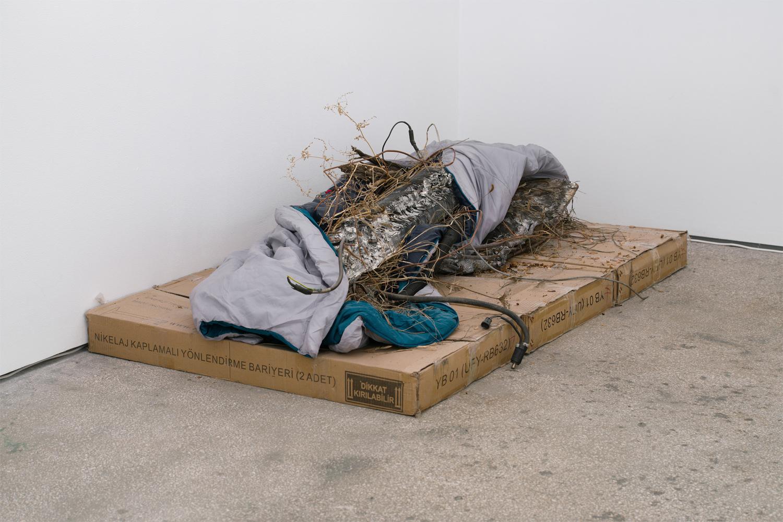 Nomadic condition 2018 Nicolas Lamas  Sleeping bag, radiator, cables, straw, ashes, cardboard, potatoes; variable dimensions