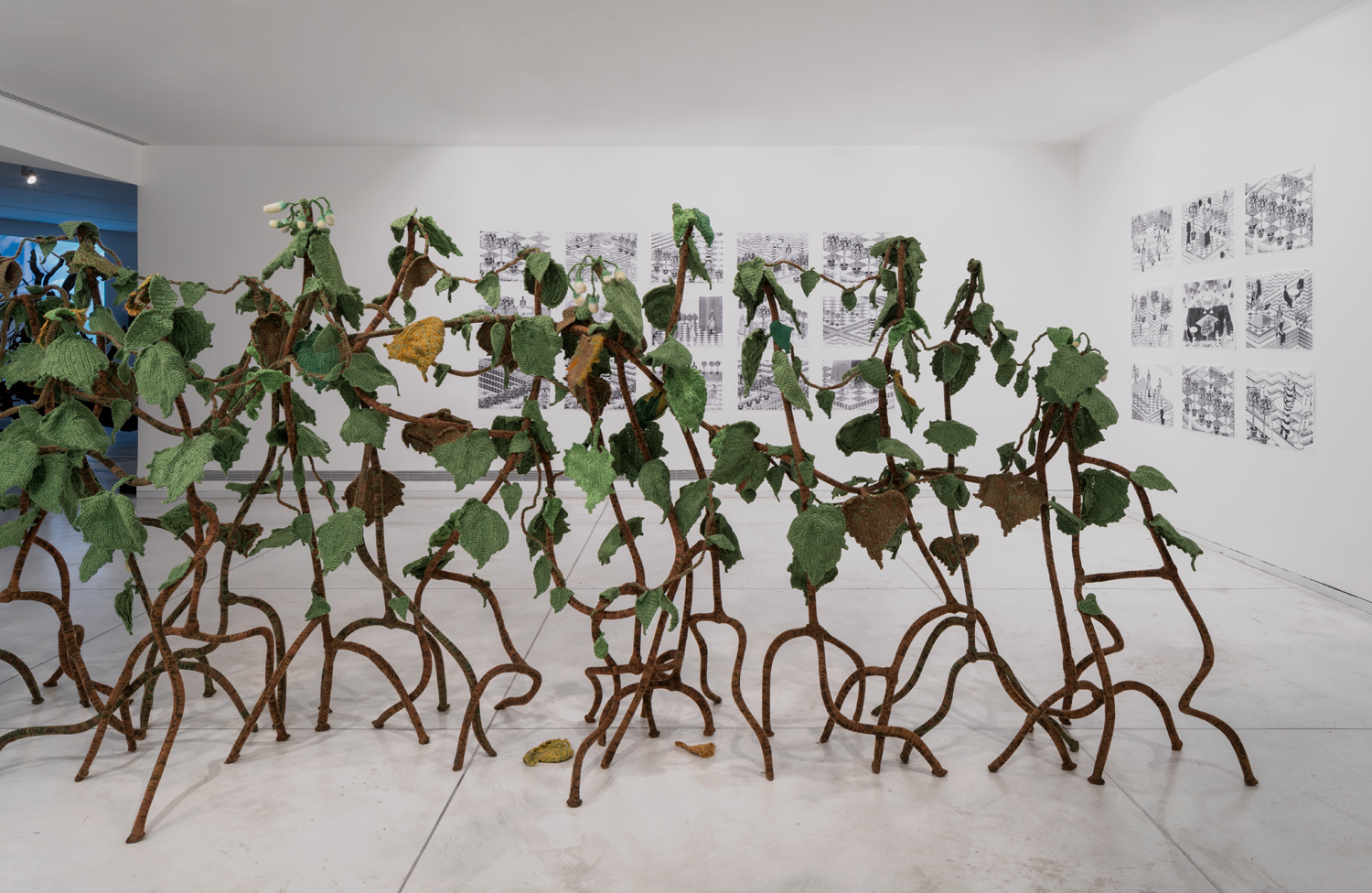 Hedgerow 2018 Gil Yefman and Kuchinate Collective Knitted   installation, wool, acrilan, felt, wire, embroidery thread, gas pipes, 250 x 750 cm Tel Aviv Museum of Art   Photo: Elad Sarig, 2018