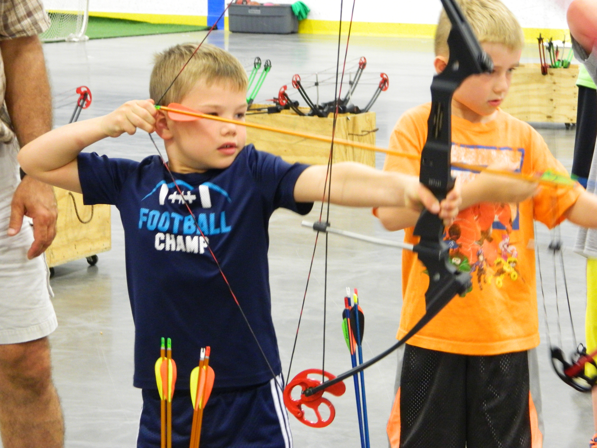 Charlie and Jackson taking aim with Mr. Jack and the AKA Archery Week - 2015