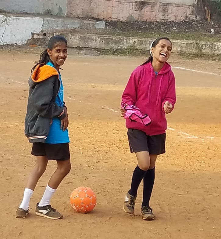 Two of the 80 girls in our Peer Sports Program.  Moving from just surviving in the slums to thriving in society.