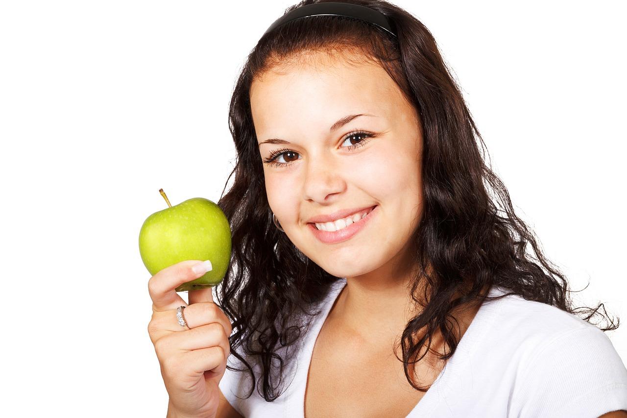 girl holding apple.jpg