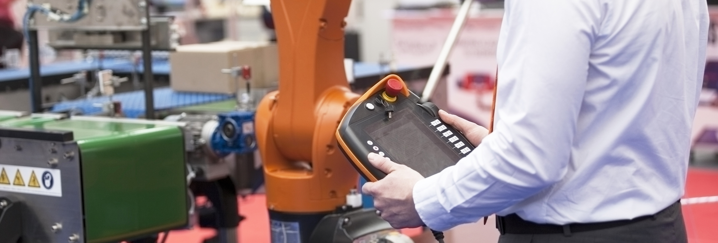 tronix Engineering, Our Approach, About, man with tablet in factory, work together, atronixengineering.com
